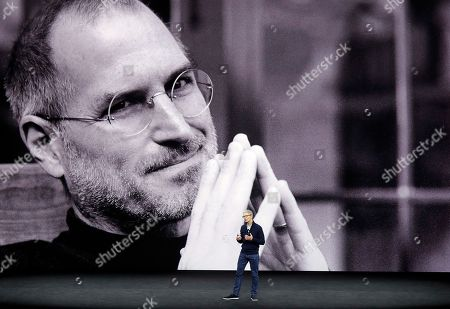 Apple CEO Tim Cook kicks off the event for a new product announcement at the Steve Jobs Theater on the new Apple campus, in Cupertino, Calif