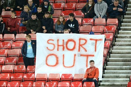 Stock Photo of Sunderland fans hold up a banner calling for their owner Ellis Short to resign