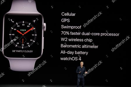 Jeff Williams, Apple's chief operating officer, shows new Apple Watch products at the Steve Jobs Theater on the new Apple campus, in Cupertino, Calif