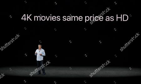 Eddy Cue, Apple's senior vice president of internet software, shows the new Apple TV product at the Steve Jobs Theater on the new Apple campus, in Cupertino, Calif
