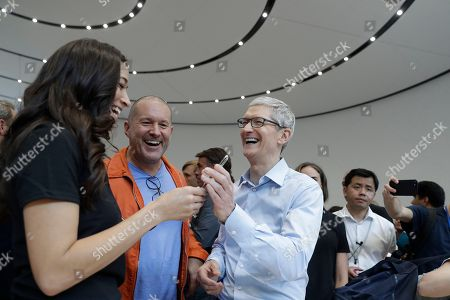Jonathan Ive, Tim Cook. Apple CEO Tim Cook, right, and Jonathan Ive, Chief Design Officer, center, display the new iPhone X in the showroom after the new product announcement at the Steve Jobs Theater on the new Apple campus, in Cupertino, Calif