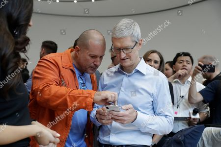 Tim Cook, Jonathan Ive. Apple CEO Tim Cook, right, and Jonathan Ive, Chief Design Officer shows the new iPhone X in the showroom after the new product announcement at the Steve Jobs Theater on the new Apple campus, in Cupertino, Calif