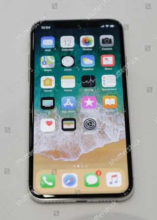 The new iPhone X is displayed in the showroom after the new product announcement at the Steve Jobs Theater on the new Apple campus, in Cupertino, Calif
