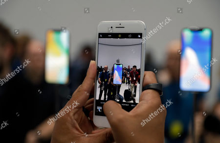 The new iPhone 8 Plus is displayed in the showroom after the new product announcement at the Steve Jobs Theater on the new Apple campus, in Cupertino, Calif