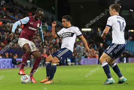 Albert Adomah of Aston Villa and Fabio Da Silva of Middlesbrough