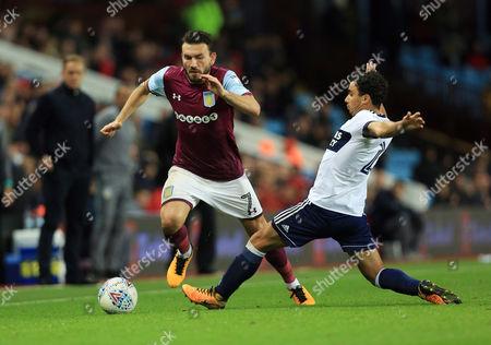 Robert Snodgrass of Aston Villa and Fabio Da Silva of Middlesbrough