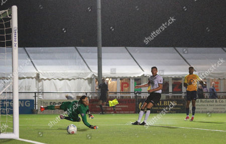 Jamie Reid Of Torquay United watches as his shot on goal narrowly goes wide of the goal post of David Gregory Of Bromley during the National League match between Bromley v Torquay United on 12th September 2017 at Hayes Lane Stadium, Bromley.
