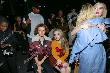 Kacy Hill, Sabrina Carpenter, Emma Roberts. Model Kacy Hill, from left, singer Sabrina Carpenter and actress Emma Roberts attend the Coach 2018 Spring/Summer Presentation, in New York