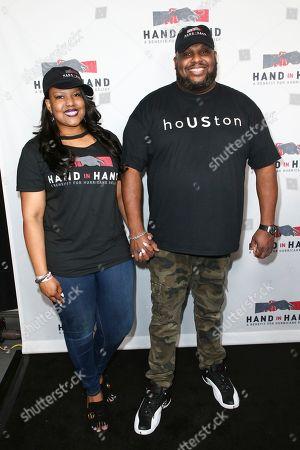 Aventer Gray, Pastor John Gray. Pastor John Gray, left, and wife Aventer Gray attend the Hand in Hand: A Benefit for Hurricane Harvey Relief held at Universal Studios Back Lot on in Universal City, Calif
