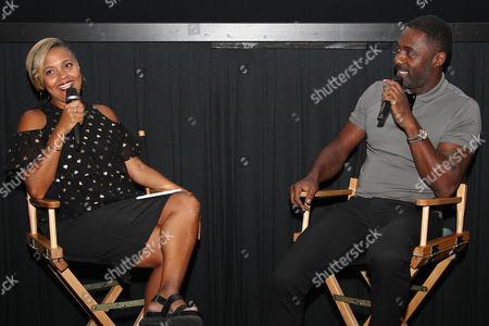 Stock Photo of Cori Murray (Entertainment Director; Essence) and Idris Elba