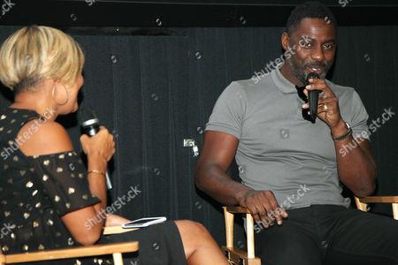 Stock Picture of Cori Murray (Entertainment Director; Essence) and Idris Elba