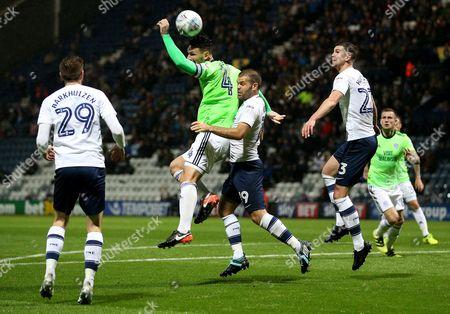 Cardiff City's Sean Morrison challenges Preston North End's John Welsh