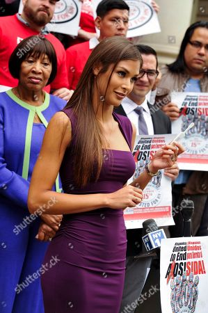 Former Miss Universe Dayana Mendoza displays the OraQuick In-Home HIV Test on the steps of City Hall on the 10th Annual National Latino HIV/AIDS Awareness Day, in New York