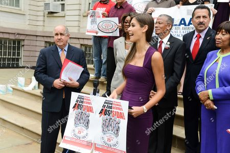 Former Miss Universe Dayana Mendoza speaks on the steps of New York City Hall on the 10th Annual National Latino HIV/AIDS Awareness Day, in New York