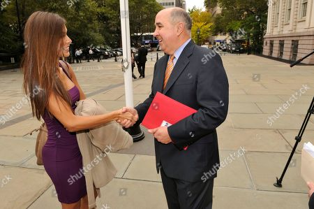 Douglas A. Michels, CEO of OraSure Technologies, speaks with former Miss Universe Dayana Mendoza on the 10th Annual National Latino HIV/AIDS Awareness Day, in New York
