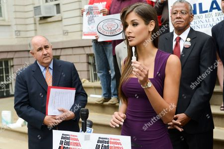 Former Miss Universe Dayana Mendoza displays the OraQuick In-Home HIV Test on the steps of New York City Hall on the 10th Annual National Latino HIV/AIDS Awareness Day, in New York