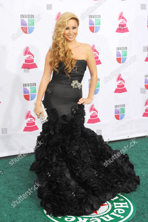 T. Lopez arrives at the 13th Annual Latin Grammy Awards at Mandalay Bay, in Las Vegas