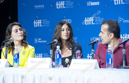 "Actresses Belçim Bilgin and Monica Bellucci and director/writer/producer Bahman Ghobadi participate in a photo call and press conference for the film ""Rhino Season"" at TIFF Bell Lightbox during the Toronto International Film Festival, in Toronto"
