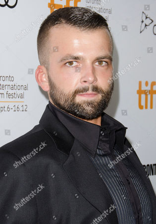 """Actor Adnan Haskovic arrives at the premiere for the film """"Twice Born"""" at Roy Thomson Hall during the Toronto International Film Festival, in Toronto"""