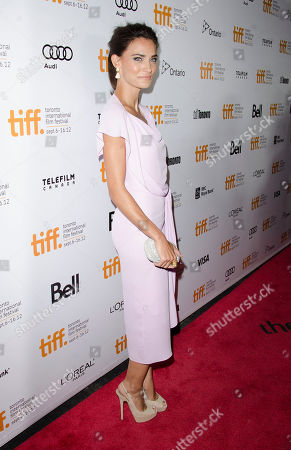 """Actress Saadet Aksoy arrives at the premiere for the film """"Twice Born"""" at Roy Thomson Hall during the Toronto International Film Festival, in Toronto"""