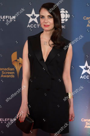 Actress Mia Kirshner poses on the red carpet at the 2014 Canadian Screen Awards on in Toronto, Canada