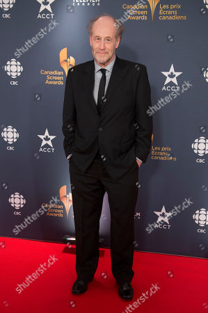 Actor Gabriel Arcand poses on the red carpet at the 2014 Canadian Screen Awards on in Toronto, Canada