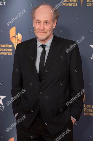 Stock Photo of Actor Gabriel Arcand poses on the red carpet at the 2014 Canadian Screen Awards on in Toronto, Canada