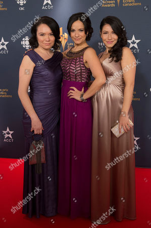 Jennifer Podemski, Sarah Podemski, and Tamara Podemski pose on the red carpet at the 2014 Canadian Screen Awards on in Toronto, Canada