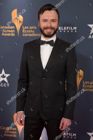 Actor Sebastien Pilote poses on the red carpet at the 2014 Canadian Screen Awards on in Toronto, Canada