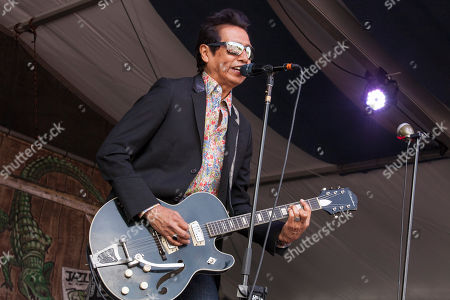 Singer/guitarist Alejandro Escovedo & The Sensitive Boys perform at the New Orleans Jazz and Heritage Festival in New Orleans on