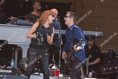 Patti Scialfa and Garry Tallent performs with Bruce Springsteen and the E Street Band at the New Orleans Jazz and Heritage Festival in New Orleans on