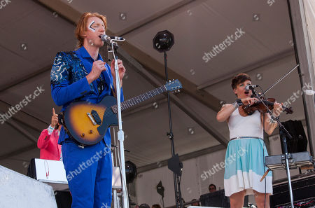Richard Parry and Sarah Neufeld of Arcade Fire perform at the New Orleans Jazz and Heritage Festival in New Orleans on