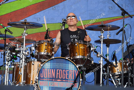 Drummer Kenny Aronoff performs with John Fogerty at the New Orleans Jazz and Heritage Festival in New Orleans on