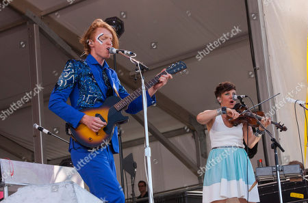 Stock Image of Richard Parry and Sarah Neufeld of Arcade Fire perform at the New Orleans Jazz and Heritage Festival in New Orleans on