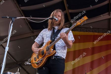 Tim Kingsbury of Arcade Fire performs at the New Orleans Jazz and Heritage Festival in New Orleans on