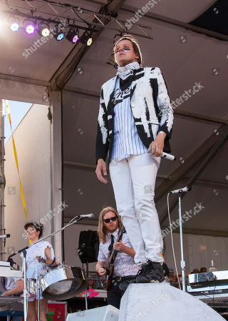 Regine Chassagne, Tim Kingsbury and Win Butler of Arcade Fire performs at the New Orleans Jazz and Heritage Festival in New Orleans on