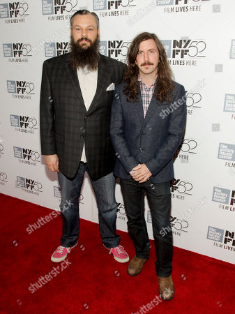 "James M. Johnston, left, and Toby Halbrooks, right, attend a screening of ""Listen Up Philip"" at the New York Film Festival on in New York"