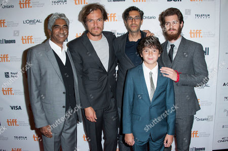 "Producer Ashok Amritraj, actors Michael Shannon and Noah Lomax, director Ramin Bahrani and actor Andrew Garfield seen at the premiere of ""99 Homes"" at the Princess of Wales Theatre during the 2014 Toronto International Film Festival, in Toronto, Ontario"