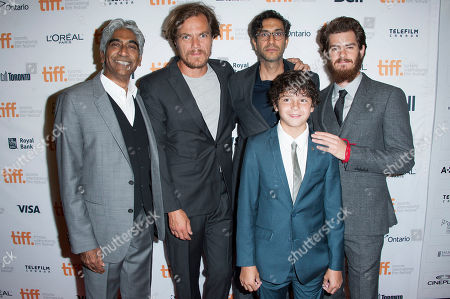 "Noah Lamox Producer Ashok Amritraj, actors Michael Shannon and Noah Lomax, director Ramin Bahrani and actor Andrew Garfield arrive at the premiere of ""99 Homes"" at the Princess of Wales Theatre during the 2014 Toronto International Film Festival, in Toronto, Ontario"