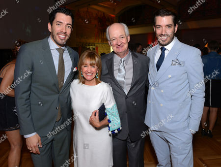 Stock Photo of Jonathan Scott and, from left, Drew Scott, Debra McGrath and Colin Mochrie attend the Producers Ball at the Royal Ontario Museum, in Toronto
