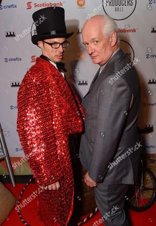 Colin Mochrie, right, attends the Producers Ball at the Royal Ontario Museum, in Toronto