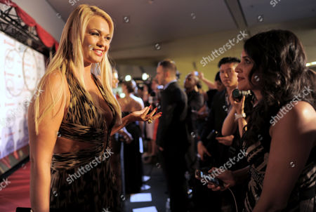 Angeline-Rose Troy, left, attends the Producers Ball at the Royal Ontario Museum, in Toronto
