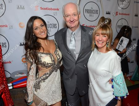 Stock Image of Sitara Hewitt and, from left, Debra McGrath and Colin Mochrie attend the Producers Ball at the Royal Ontario Museum, in Toronto
