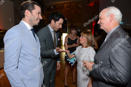 Jonathan Scott and, from left, Drew Scott, Debra McGrath and Colin Mochrie attend the Producers Ball at the Royal Ontario Museum, in Toronto