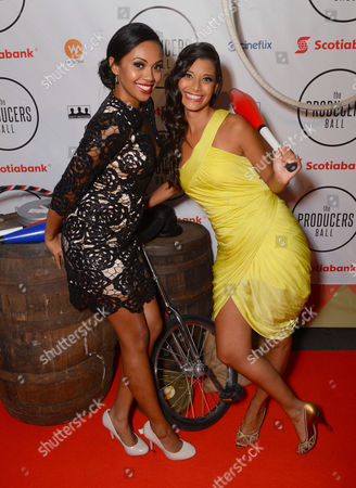 Mishael Morgan, left, and Andrea Drepaul attend the Producers Ball at the Royal Ontario Museum, in Toronto