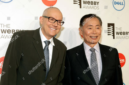 Actor George Takei, right, with husband Brad Altman, left, attends the 2014 Webby Awards, in New York