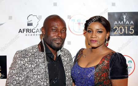 Stock Image of Hatian actor Jimmy Jean-Louis and Nigerian actress Omotola Jalade Ekeinde seen at 2015 AMAA Nominations Dinner at H.O.M.E., in Beverly Hills, Calif