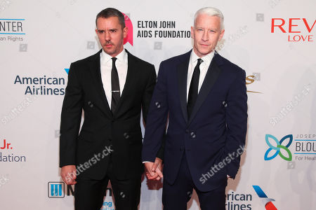 """Benjamin Maisani, left, and Anderson Cooper, right, attend the Elton John AIDS Foundation's 14th Annual """"An Enduring Vision"""" Benefit at Cipriani Wall Street, in New York"""