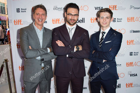 """Tim Kring, from left, Ryan Guzman and Robbie Kay attend a premiere for """"Heroes Reborn"""" on day 6 of the Toronto International Film Festival at The Winter Garden Theatre, in Toronto"""