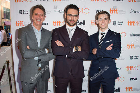 """Tim Kring, Ryan Guzman and Robbie Kay attend a premiere for """"Heroes Reborn"""" on day 6 of the Toronto International Film Festival at The Winter Garden Theatre, in Toronto"""
